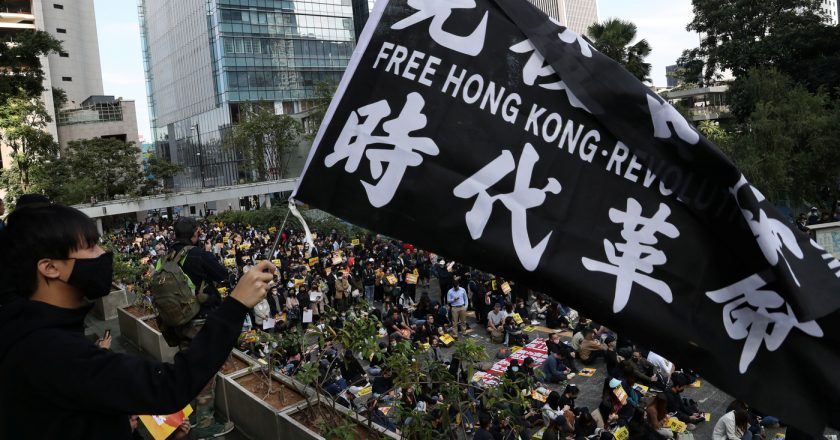 China threatens to revoke licence of lawyer who helped HK activist